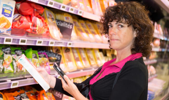 Woman comparing prices at the supermarket