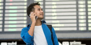 Man calling phone in airport