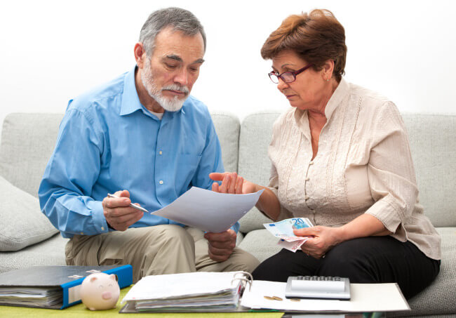Elderly couple doing budget and money