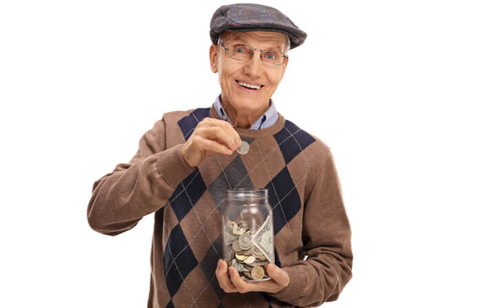 Old man saving money in a jar